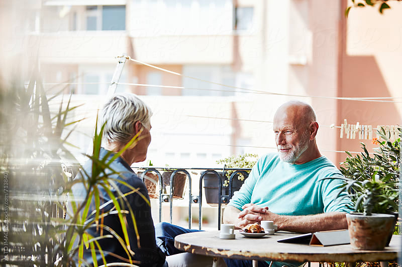 Senior Man Having Breakfast With Woman On Balcony by ALTO IMAGES for Stocksy United