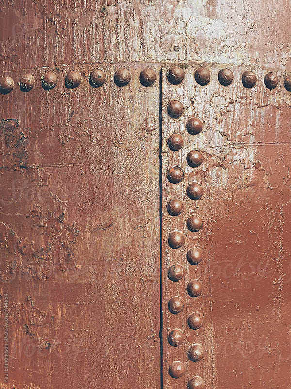 Close of rusty, brown metal wall by Paul Edmondson for Stocksy United