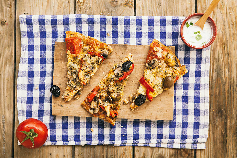 Vegetarian Pizza Slices by Lumina for Stocksy United