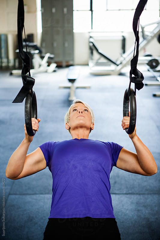 Woman working out in the gym by Suprijono Suharjoto for Stocksy United