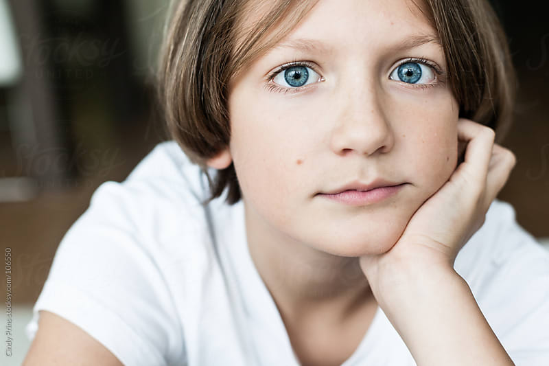 Portrait of a boy with blue eyes and blond hair by Cindy Prins for Stocksy United