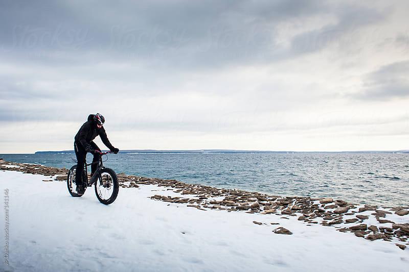 Extreme Sport Winter Mountain Biking Man Riding Bike In Snow by JP Danko for Stocksy United