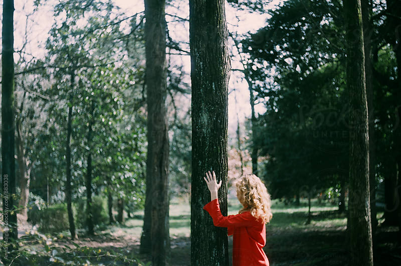 A film photo of redhead woman in the park by Anna Malgina for Stocksy United