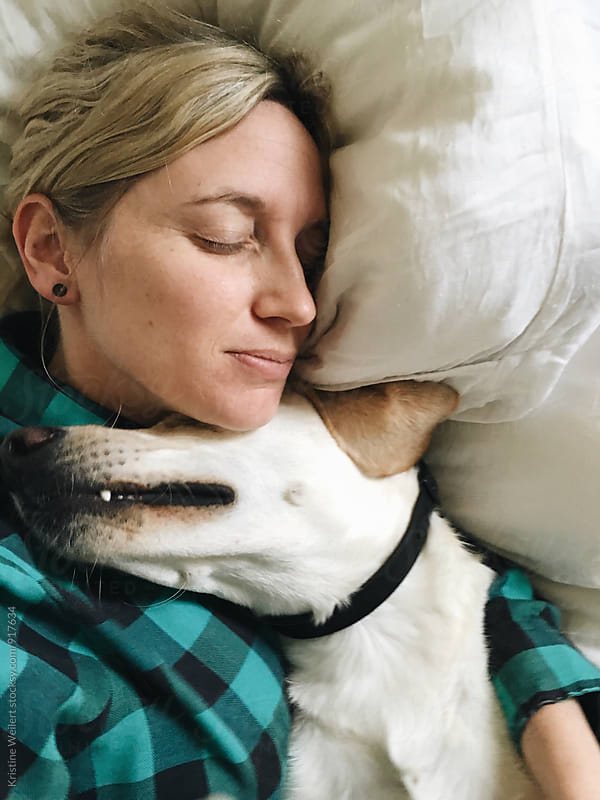 Woman laying with her dog by We Are SISU for Stocksy United