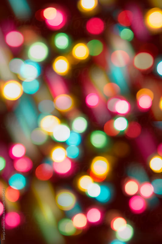 colorful party lights in blur background by Sonja Lekovic for Stocksy United
