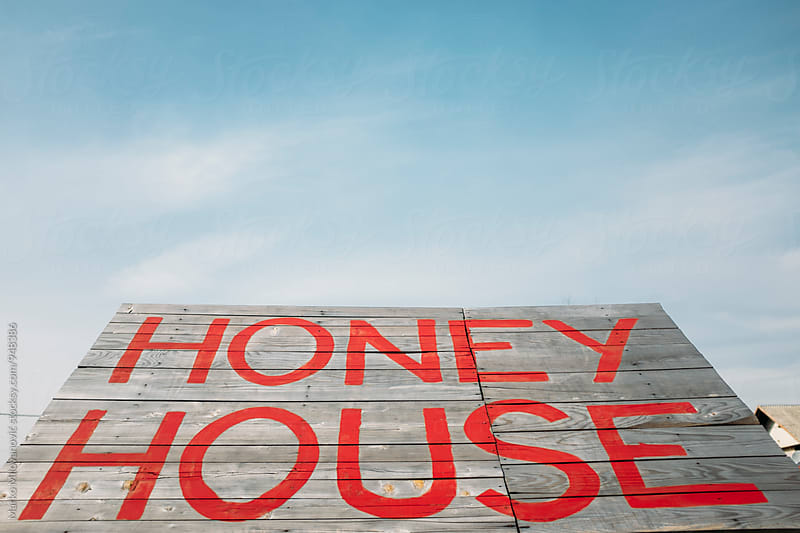 Honey house sign near the road by Marko Milovanović for Stocksy United
