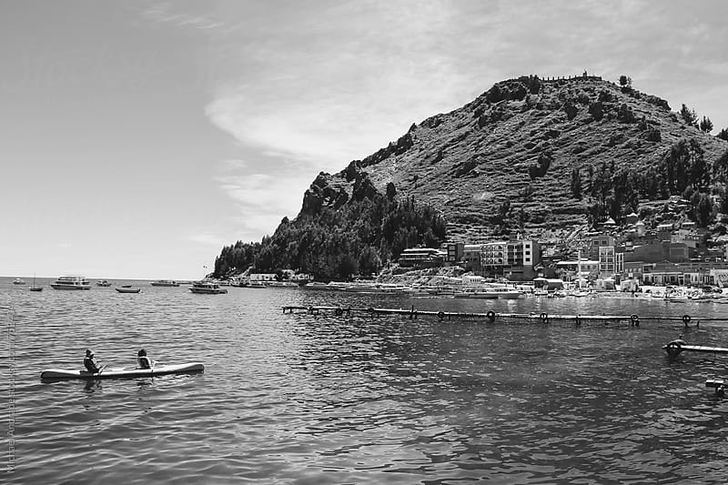 boat sailing through the lake in la paz, bolivia by Michael Andrade for Stocksy United