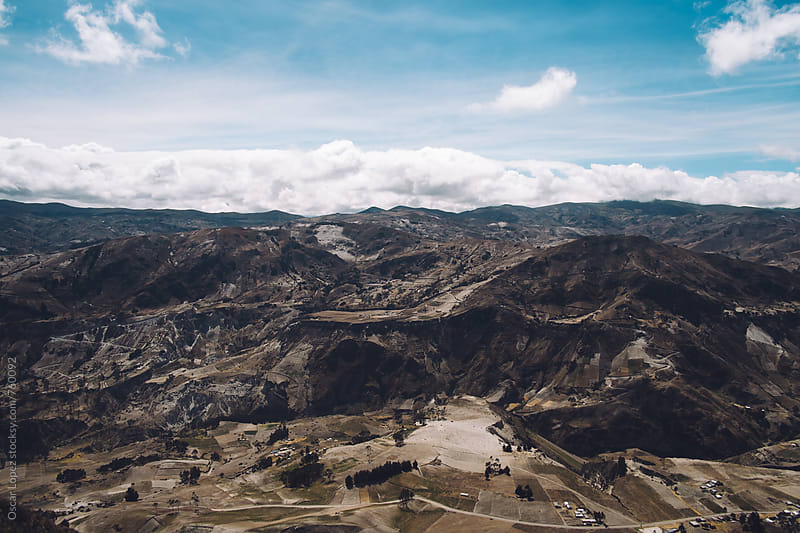 Landscape of Rugged Ecuadorian Mountains dotted with Farmland by Oscar Lopez for Stocksy United