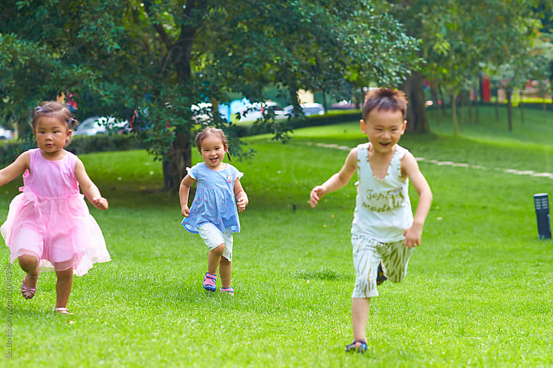 happy kids playing outdoor in the park by Bo Bo for Stocksy United