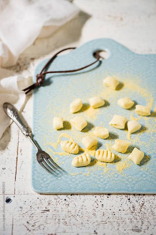 Preparing ricotta gnocchi step by step by Laura Adani for Stocksy United