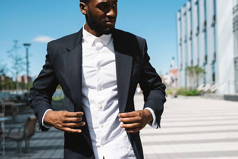 Black businessman walking in the street by GIC for Stocksy United