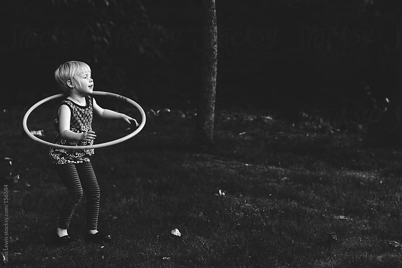 young girl with hula hoop by Jess Lewis for Stocksy United
