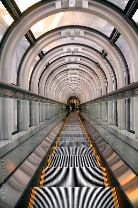 Escalator  by Erik Naumann for Stocksy United