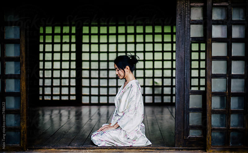 Beautiful Japanese woman in casual silky kimono sitting in traditional Japanese house by Nabi Tang for Stocksy United