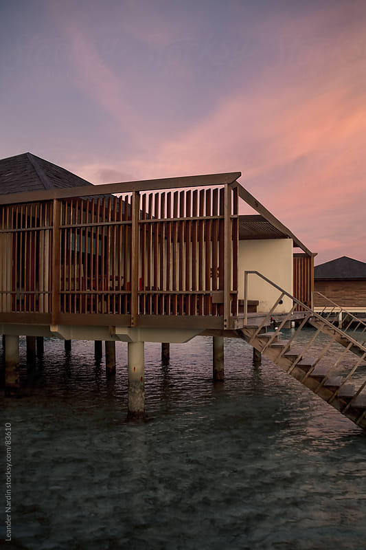 Watervilla on the maledives at sunset by Leander Nardin for Stocksy United