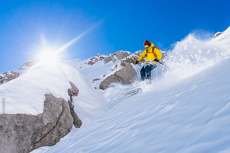 Powder skiing in the mountains of Austria by Søren Egeberg Photography for Stocksy United