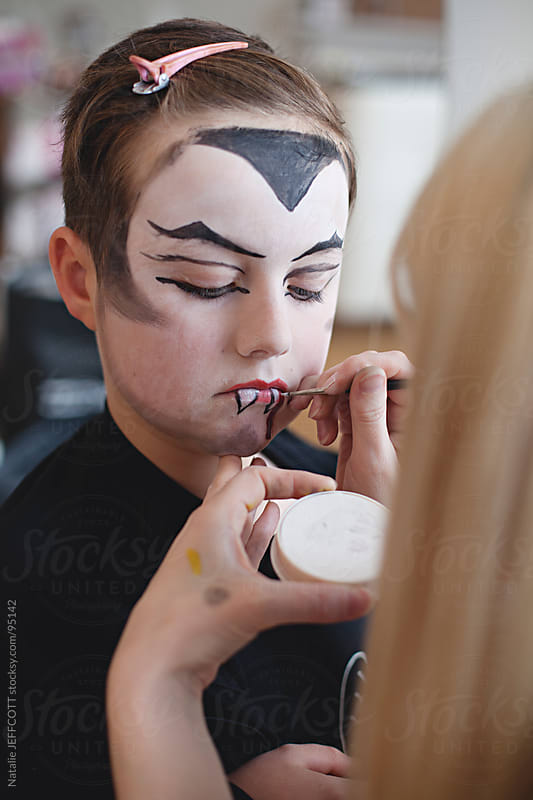 getting face paint applied for halloween by Natalie JEFFCOTT for Stocksy United