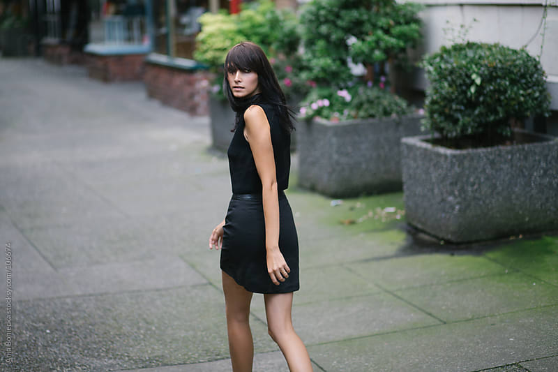 A beautiful brunette walking away from camera  by Ania Boniecka for Stocksy United