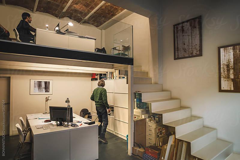 Interior designer men working in his creative workspace. by BONNINSTUDIO for Stocksy United