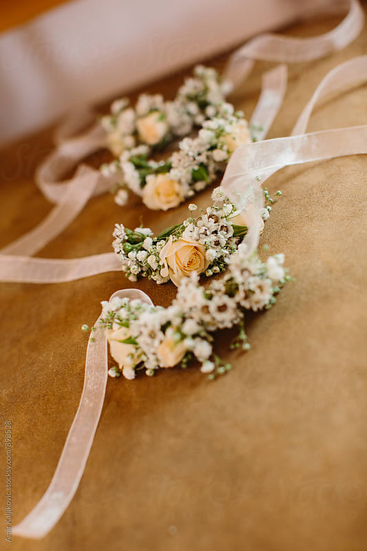 Close up of wedding ribbon accessory by Amir Kaljikovic for Stocksy United