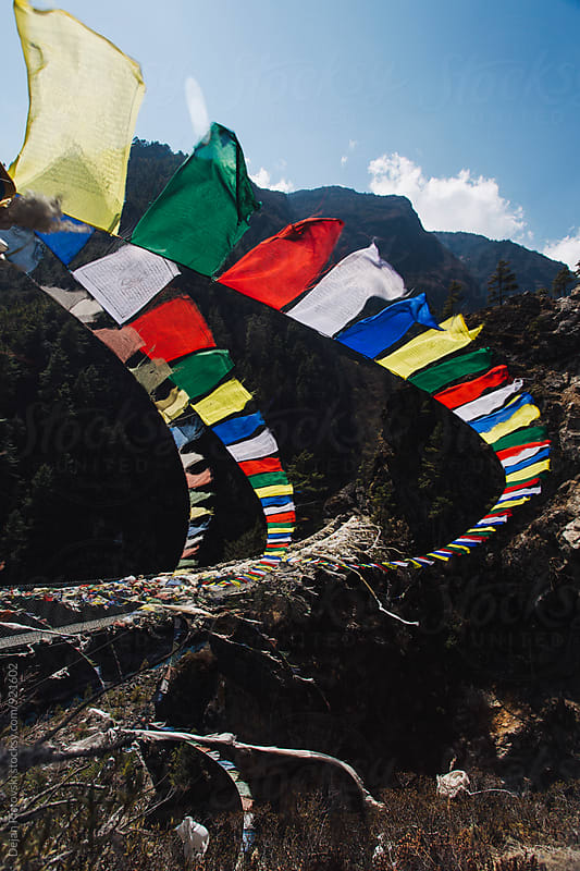 Flying tibetan prayer flags by Dejan Ristovski for Stocksy United
