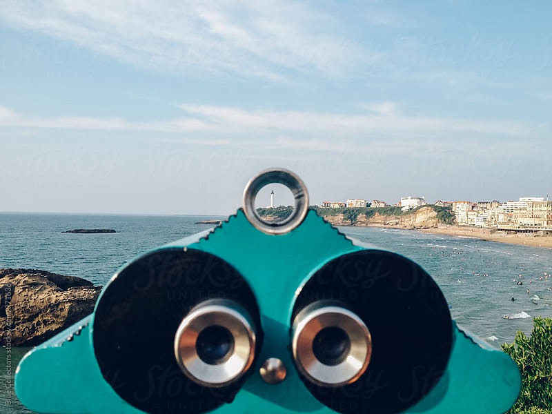 Boardwalk binoculars overlooking the coast by Jordi Rulló for Stocksy United