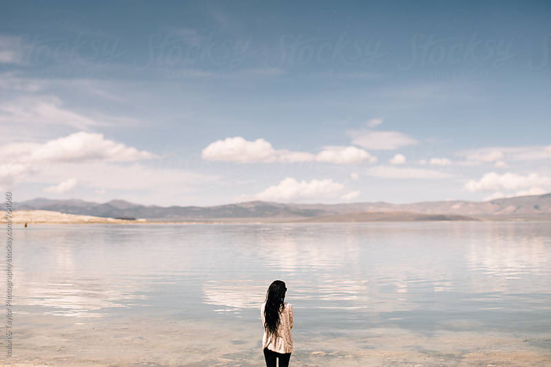 Woman enjoying lake view by Isaiah & Taylor Photography for Stocksy United