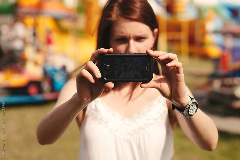 Woman taking pictures with smart phone camera by Aleksandra Kovac for Stocksy United