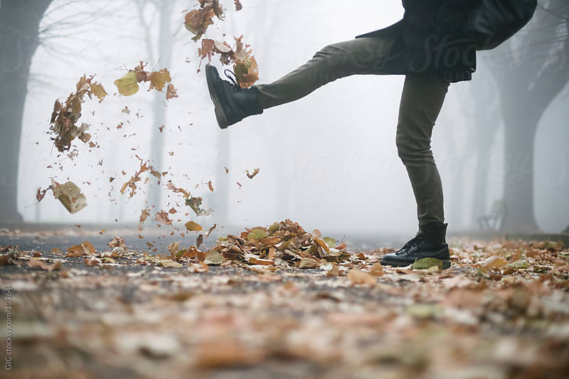 Woman walking in the park during a foggy day - winter by GIC for Stocksy United