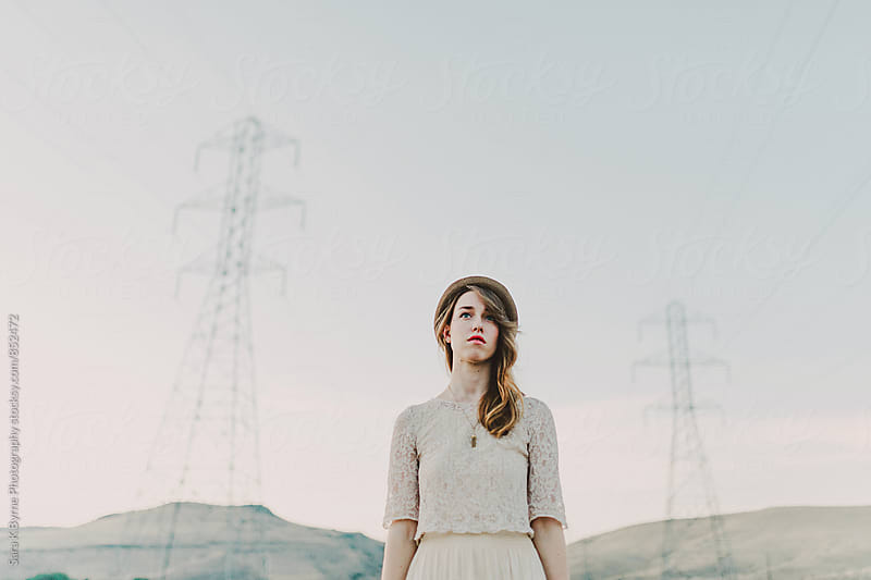 Girl & Power lines by Sara K Byrne Photography for Stocksy United