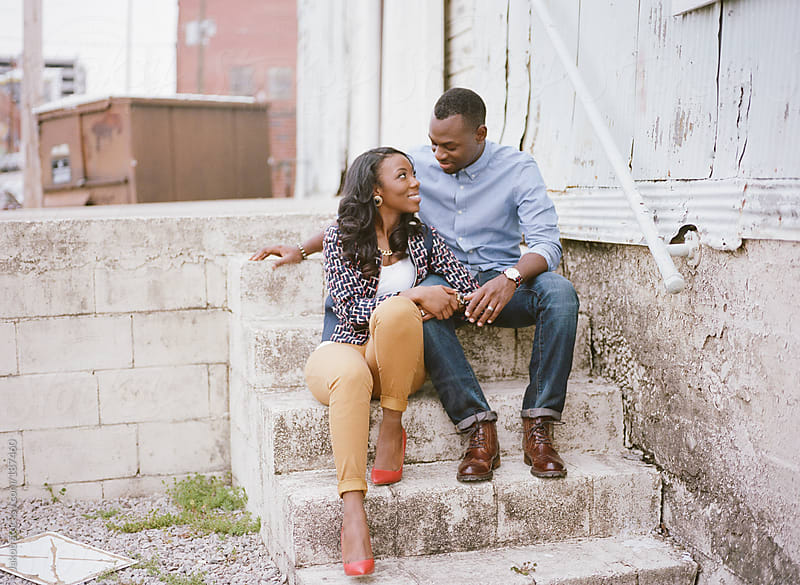 A stylish and fashionable  African-American couple in an urban setting by Jakob for Stocksy United