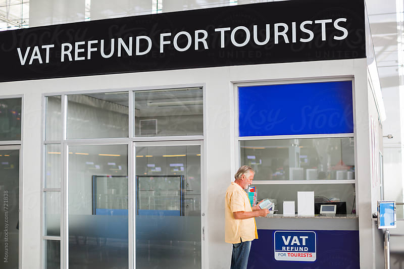 Man at the VAT Refund Counter by Mosuno for Stocksy United