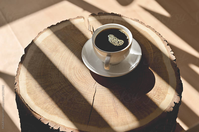 Cup of coffee on a wood log by RG&B Images for Stocksy United