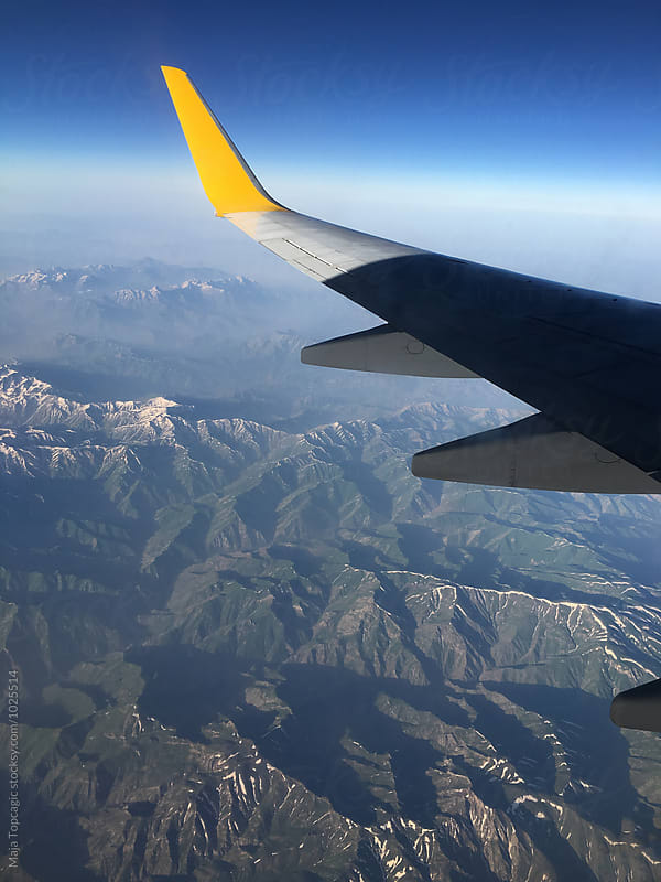 Aeroplane shot of mountains by Maja Topcagic for Stocksy United