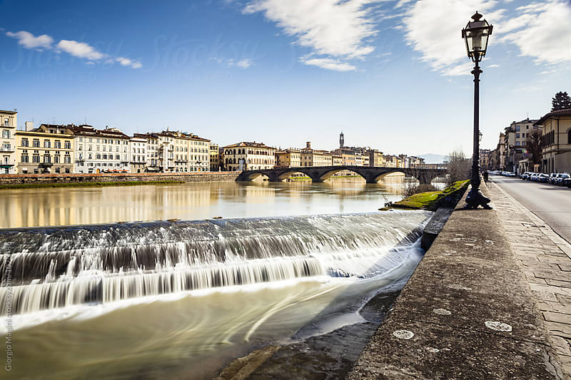 Arno River and Ponte alla Carraia Bridge in Florence, Italy by Giorgio Magini for Stocksy United