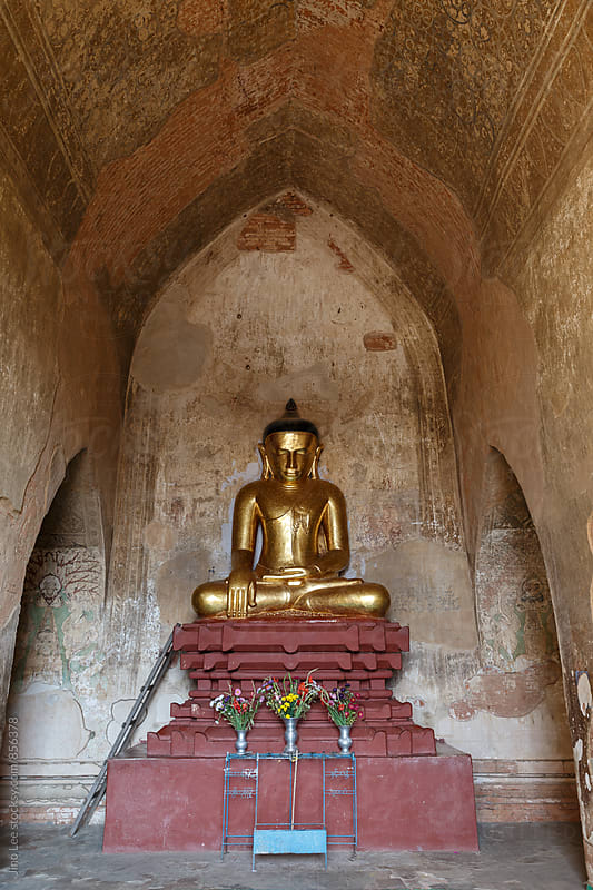 Buddha statue inside Bagan stupa by Jino Lee for Stocksy United