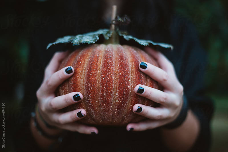 Holding a Sparkling pumpkin by Giada Canu for Stocksy United