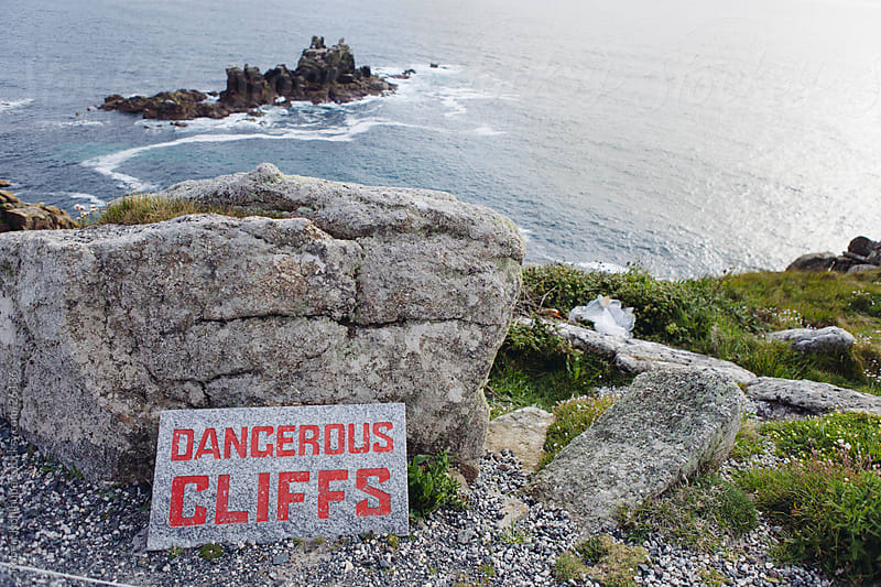Dangerous cliffs warning sign by Robert Kohlhuber for Stocksy United