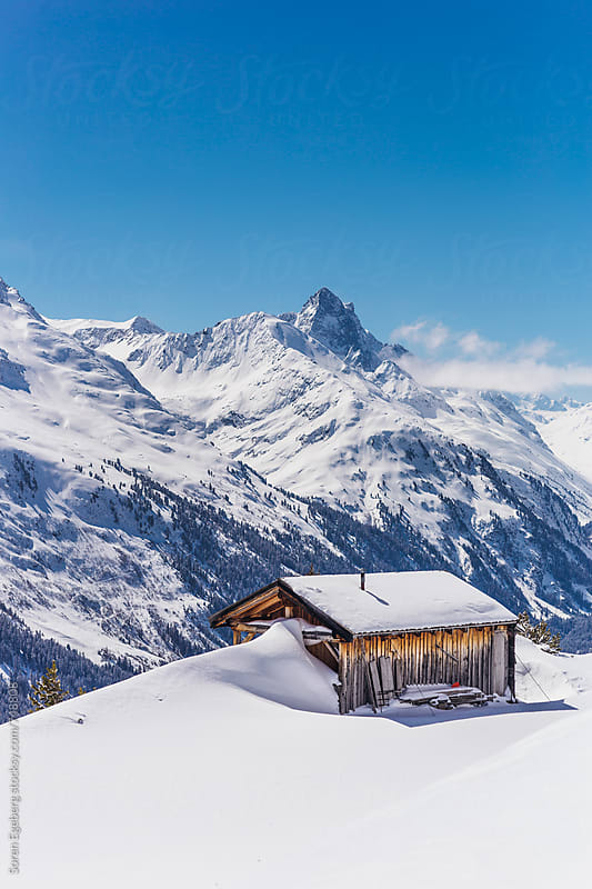 Winter mountain cabin covered in snow by Søren Egeberg Photography for Stocksy United