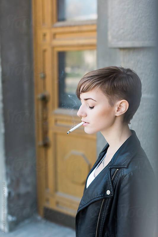 androgyne  smoking by Vesna for Stocksy United
