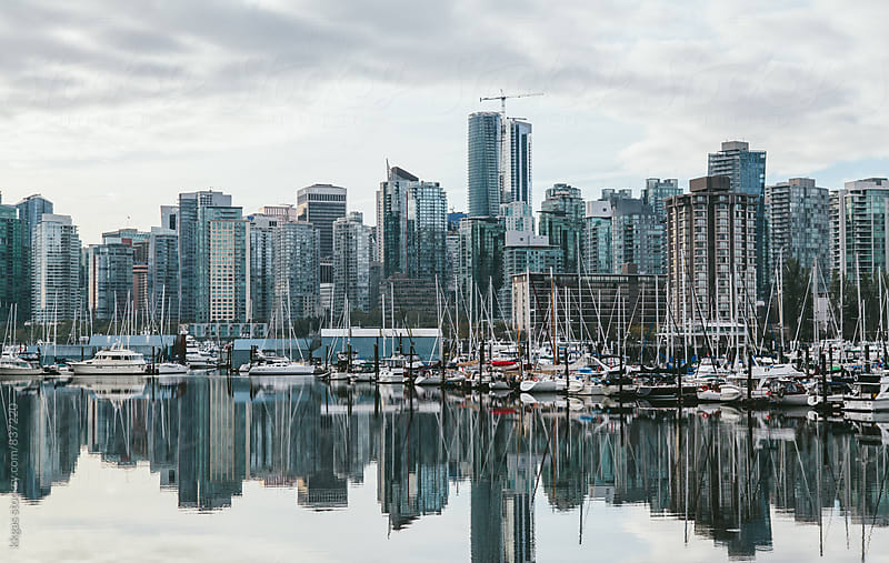 Vancouver habour cityscape with boats in the foreground. by kkgas for Stocksy United