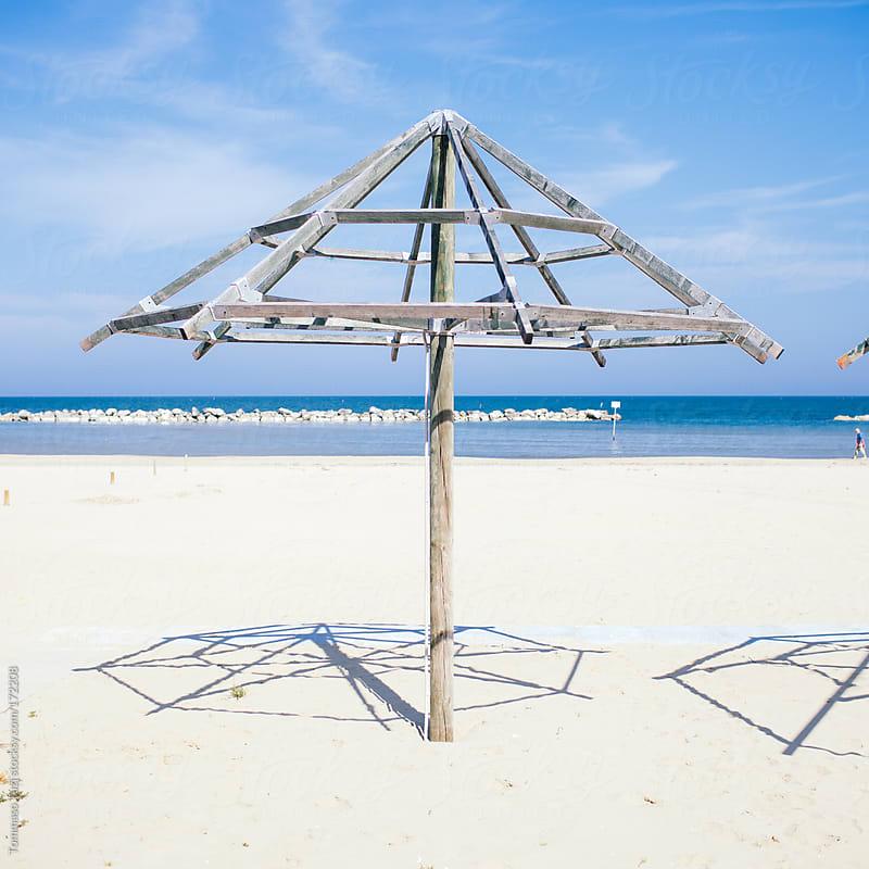 deserted beach by Tommaso Tuzj for Stocksy United