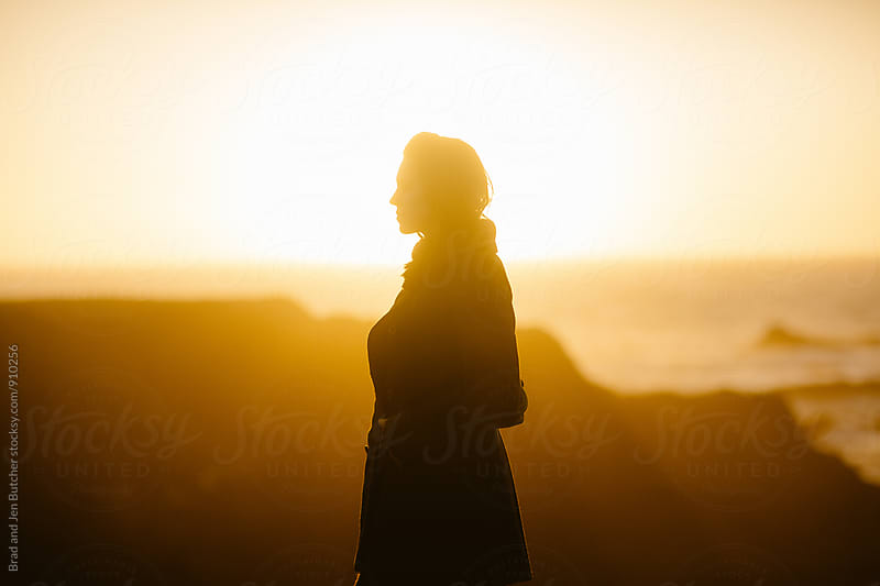 Woman's Silhouette in Sunset by Brad and Jen Butcher for Stocksy United