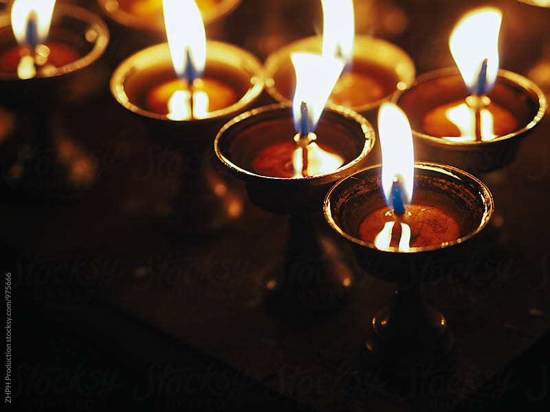 Candlelights at the temple by ZHPH Production for Stocksy United
