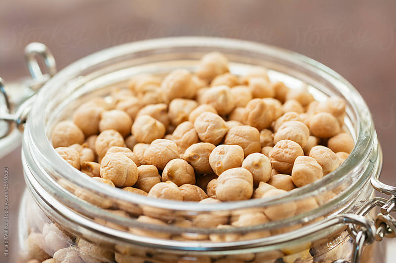 Chickpeas in a jar by Harald Walker for Stocksy United