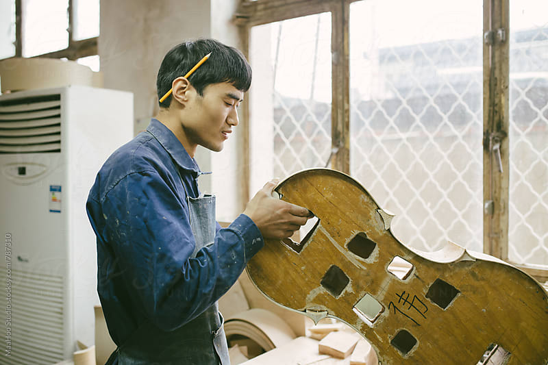 Violoncello maker at work by Maa Hoo for Stocksy United