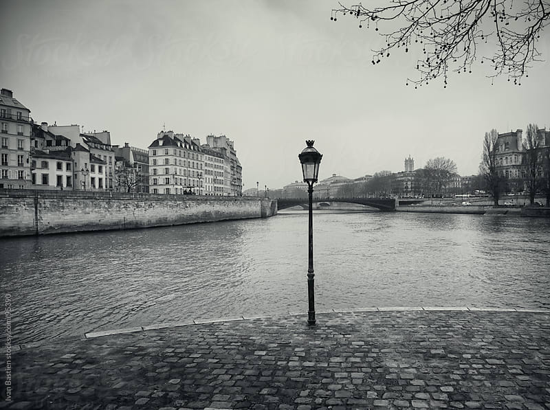 Old street lamp on Seine riverbanks in Paris, France by Ivan Bastien for Stocksy United