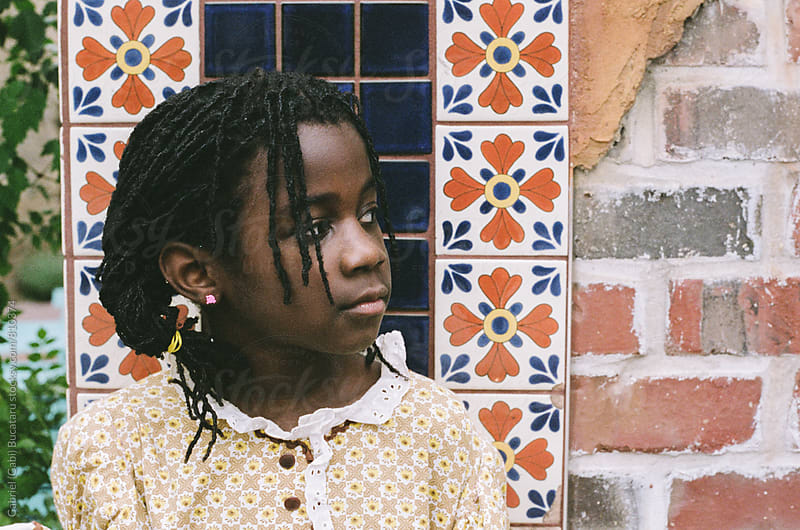 Cute African American girl in old fashioned dress by Gabriel (Gabi) Bucataru for Stocksy United