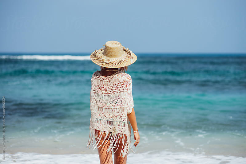 Young Woman In A Straw Hat at the Tropical Beach by Alexander Grabchilev for Stocksy United
