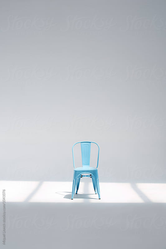 Blue chair in a white studio by Miquel Llonch for Stocksy United